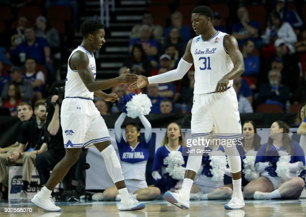 Myles Cale and Angel Delgado of the Seton Hall Pirates celebrate in the second half against the North Carolina State Wolfpack during the first round...