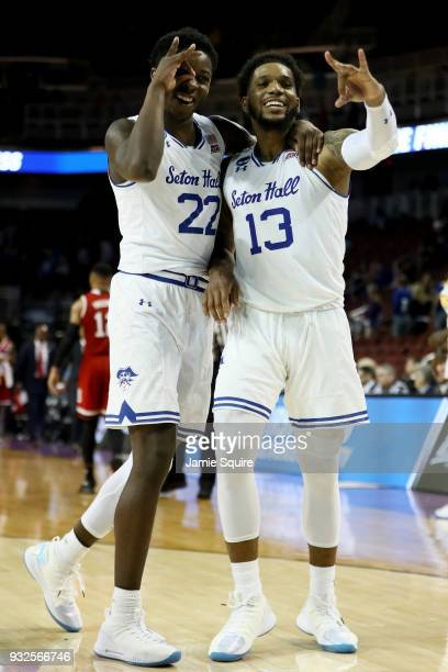 Myles Cale and Myles Powell of the Seton Hall Pirates celebrate after beating the North Carolina State Wolfpack 9483 during the first round of the...