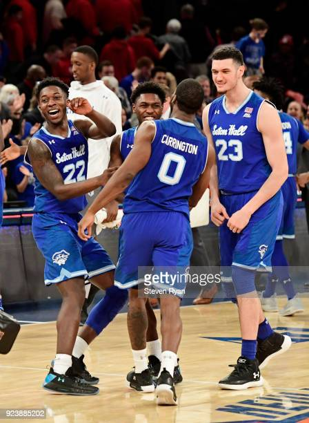 Myles Cale Jordan Walker Khadeen Carrington and Sandro Mamukelashvili of the Seton Hall Pirates celebrate their teams 8174 win after defeating the St...