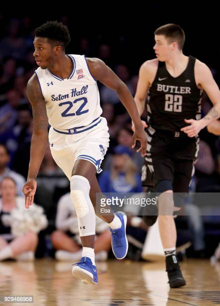 Myles Cale of the Seton Hall Pirates celebrates his three point shot as Sean McDermott of the Butler Bulldogs defends during quarterfinals of the Big...