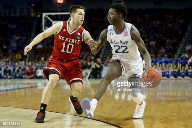 Myles Cale of the Seton Hall Pirates dribbles the ball while being guarded by Braxton Beverly of the North Carolina State Wolfpack in the first half...