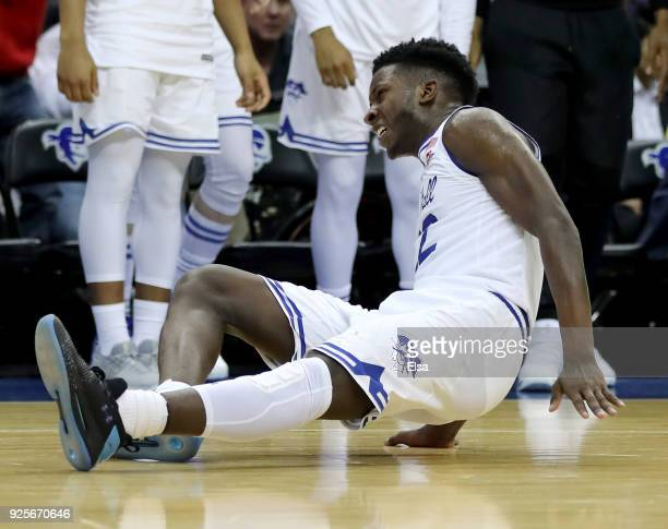 Myles Cale of the Seton Hall Pirates falls after injuring himself on a dunk in the overtime period against the Villanova Wildcats on February 28 2018...