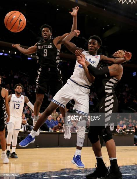 Myles Cale of the Seton Hall Pirates fights for the ball with Kamar Baldwin and Tyler Wideman of the Butler Bulldogs during quarterfinals of the Big...