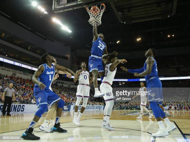 Myles Cale of the Seton Hall Pirates shoots on Silvio De Sousa of the Kansas Jayhawks in the second half during the second round of the 2018 NCAA...