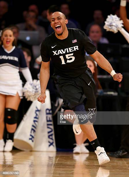 Myles Davis of the Xavier Musketeers celebrates his shot in overtime against the Butler Bulldogs during a quarterfinal game of the Big East...