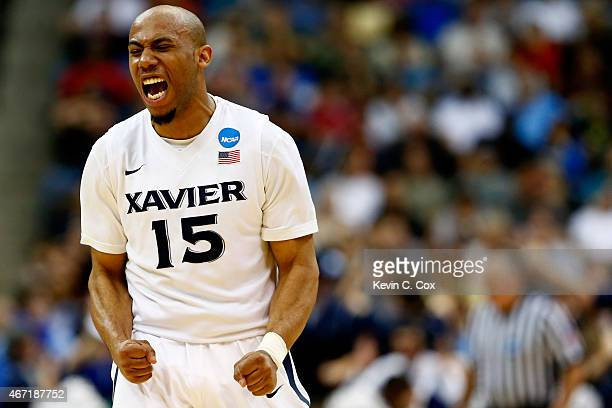 Myles Davis of the Xavier Musketeers reacts to a threepoint basket against the Georgia State Panthers in the second half during the third round of...