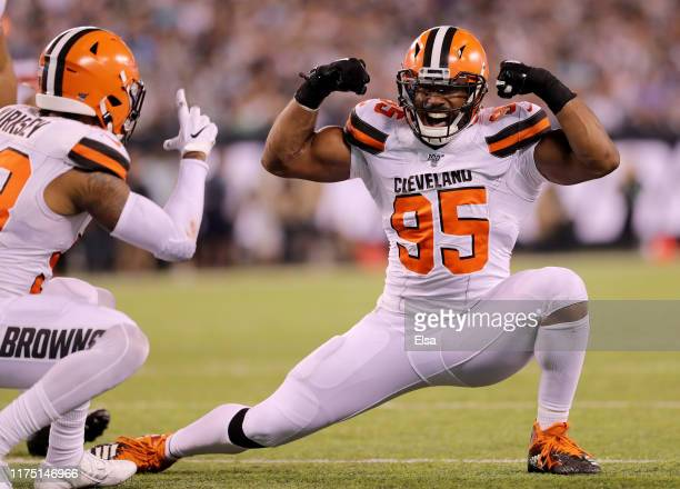 Myles Garrett of the Cleveland Browns celebrates with teammate Christian Kirksey after Garrett sacked Luke Falk of the New York Jets in the third...
