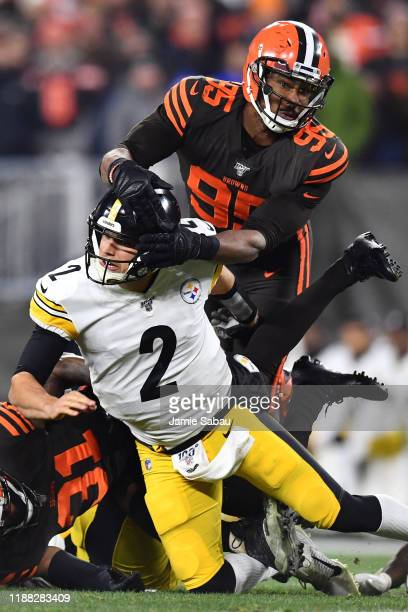 Myles Garrett of the Cleveland Browns harasses quarterback Mason Rudolph of the Pittsburgh Steelers at FirstEnergy Stadium on November 14, 2019 in...