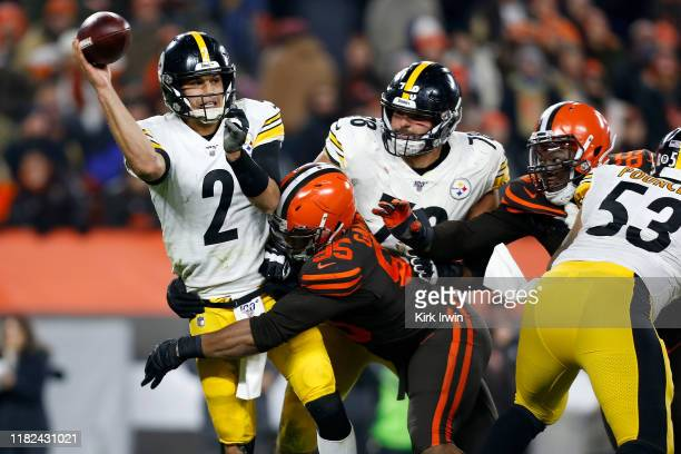 Myles Garrett of the Cleveland Browns knocks down Mason Rudolph of the Pittsburgh Steelers during the fourth quarter at FirstEnergy Stadium on...