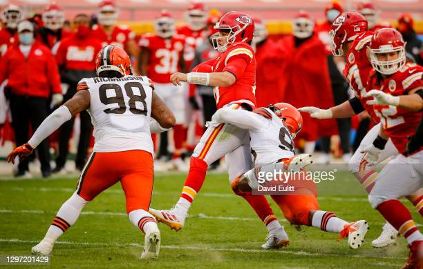 Myles Garrett of the Cleveland Browns pressures Patrick Mahomes of the Kansas City Chiefs in the third quarter of the AFC Divisional Playoff at...