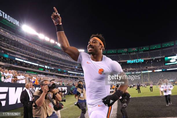 Myles Garrett of the Cleveland Browns runs off the field after defeating the New York Jets at MetLife Stadium on September 16 2019 in East Rutherford...