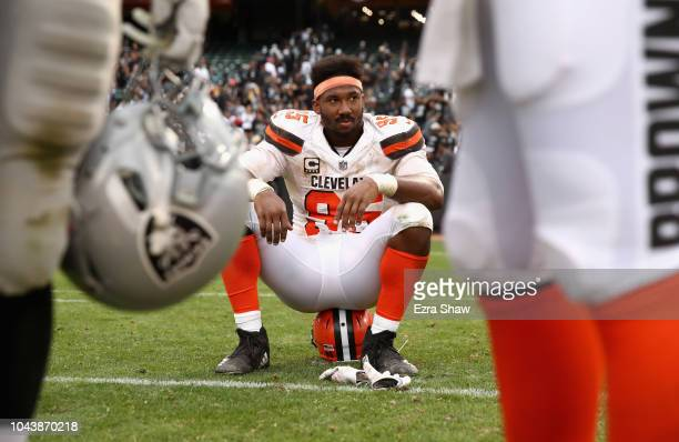 Myles Garrett of the Cleveland Browns sits on the field after the Browns lost to the Oakland Raiders in overtime at OaklandAlameda County Coliseum on...