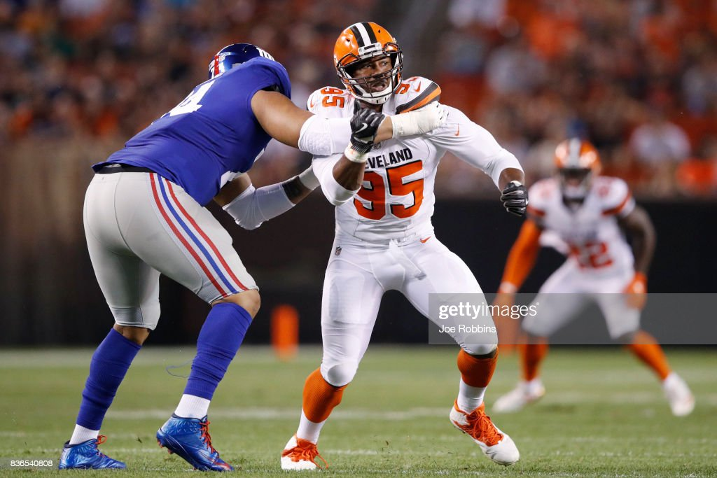 Myles Garrett #95 of the Cleveland Browns tries to get past a block by Ereck Flowers #74 of the New York Giants in the first half of a preseason game at FirstEnergy Stadium on August 21, 2017 in Cleveland, Ohio.