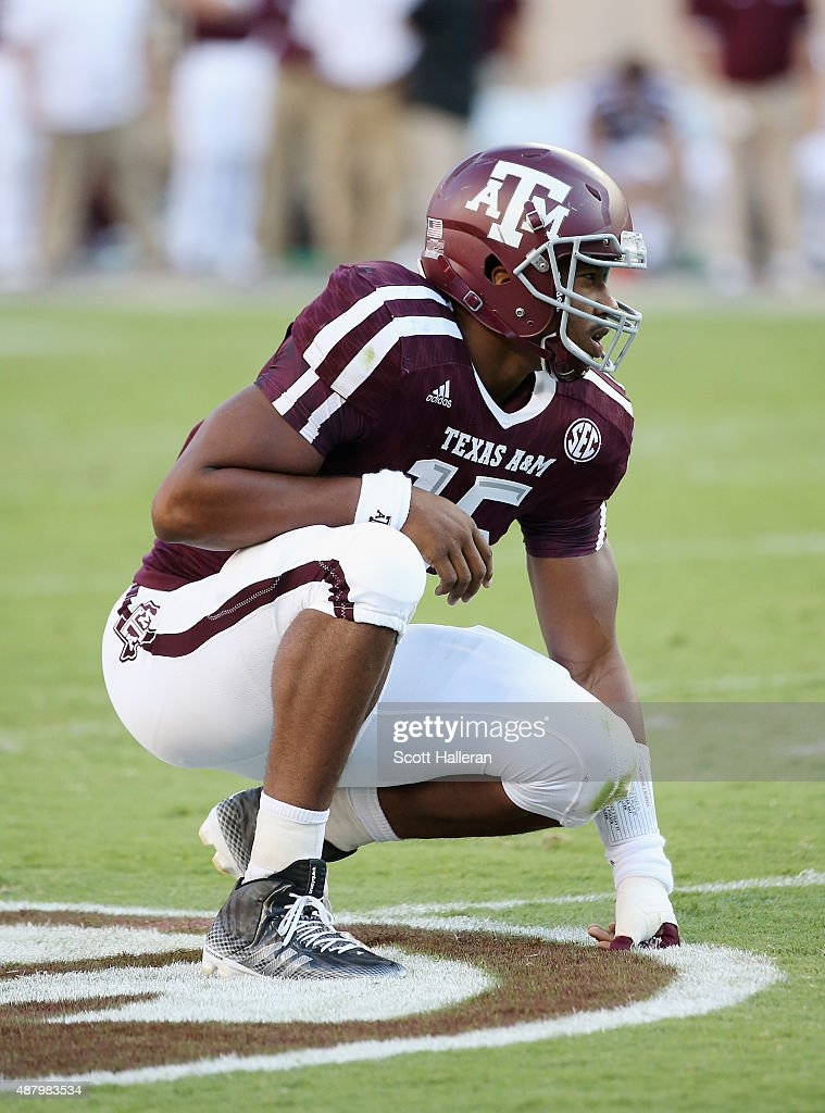 Myles Garrett #15 of the Texas A&M Aggies waits on the field in the first half of their game against the Ball State Cardinals at Kyle Field on September 12, 2015 in College Station, Texas.