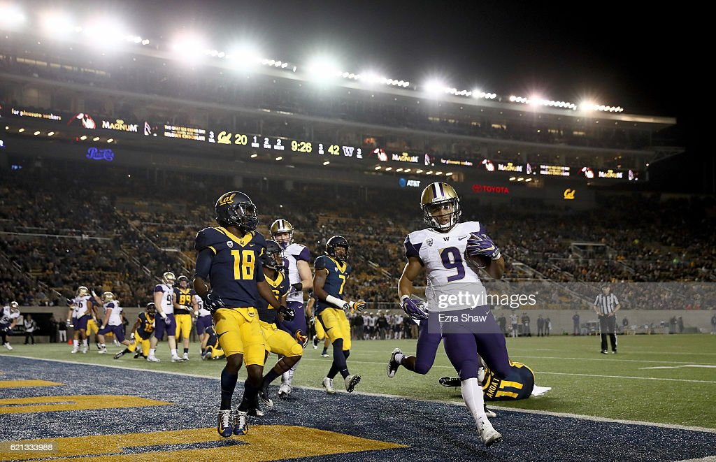 Myles Gaskin #9 of the Washington Huskies runs the ball in for a touchdown against the California Golden Bears at California Memorial Stadium on November 5, 2016 in Berkeley, California.