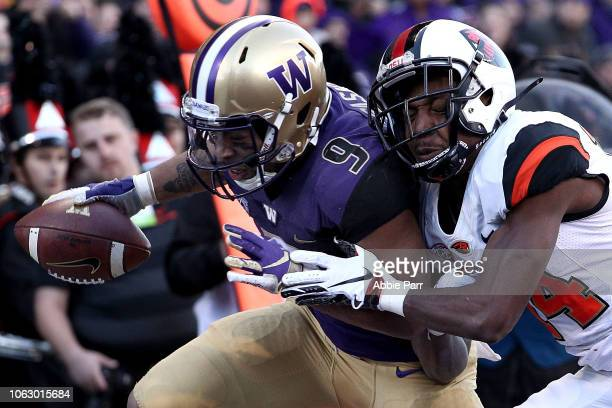 Myles Gaskin of the Washington Huskies scores a 10 yard touchdown against Kaleb Hayes of the Oregon State Beavers in the second quarter during their...