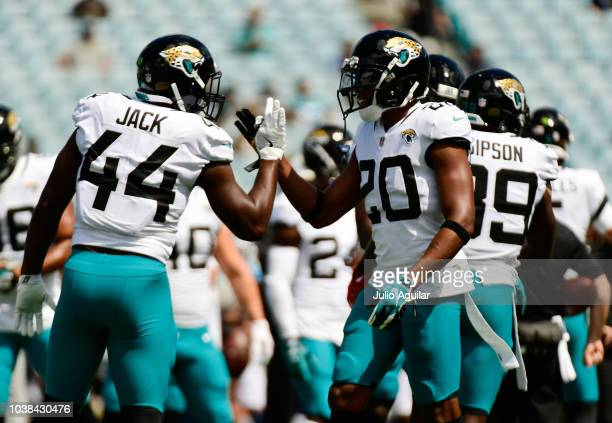 Myles Jack and Jalen Ramsey of the Jacksonville Jaguars work on the field before the start of their game against the Tennessee Titans at TIAA Bank...