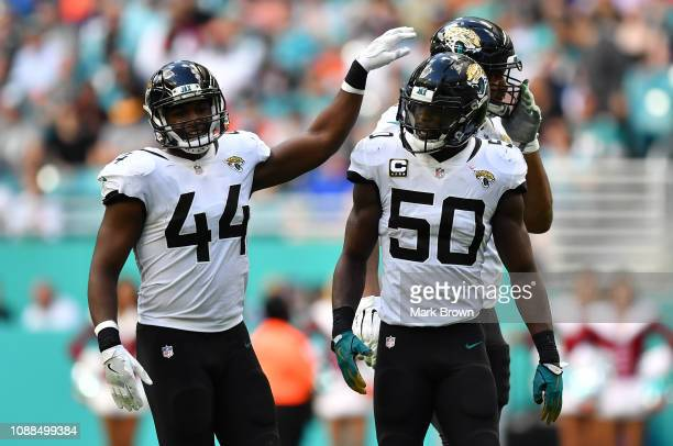 Myles Jack, Calais Campbell and Telvin Smith of the Jacksonville Jaguars in action against the Miami Dolphins at Hard Rock Stadium on December 23,...