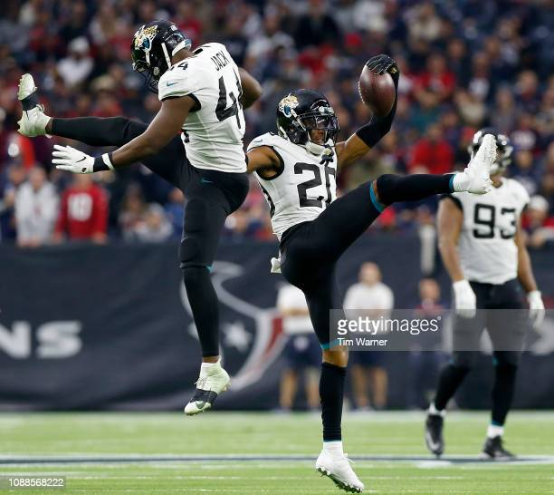 Myles Jack of the Jacksonville Jaguars celebrates with Jalen Ramsey in the second half against the Houston Texans at NRG Stadium on December 30 2018...