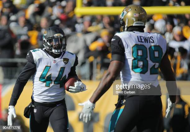 Myles Jack of the Jacksonville Jaguars celebrates with Marcedes Lewis after intercepting a pass in the first quarter during the AFC Divisional...