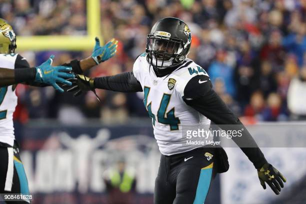 Myles Jack of the Jacksonville Jaguars celebrates with teammatesafter forcing a fumble in the second half during the AFC Championship Game against...