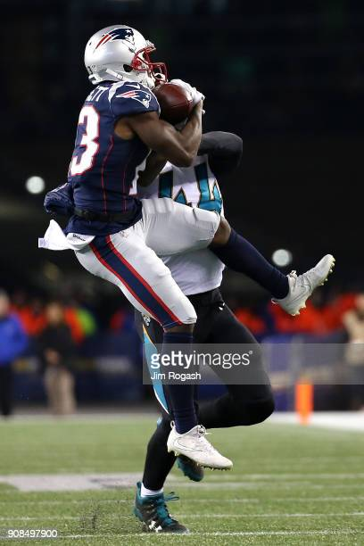 Myles Jack of the Jacksonville Jaguars defends Phillip Dorsett of the New England Patriots in the second half during the AFC Championship Game at...