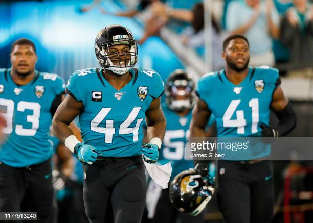 Myles Jack of the Jacksonville Jaguars enters the field with teammates Josh Allen and Calais Campbell before the start of a game against the...