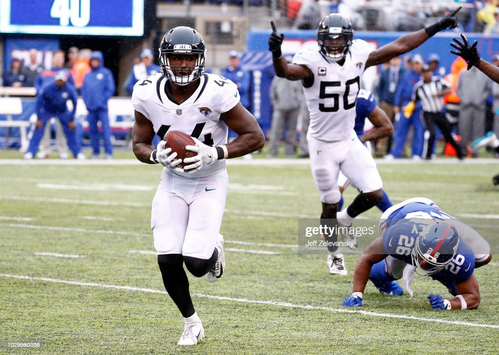 Myles Jack #44 of the Jacksonville Jaguars intercepts a pass in the fourth quarter and runs for a touchdown against the New York Giants at MetLife Stadium on September 9, 2018 in East Rutherford, New Jersey.