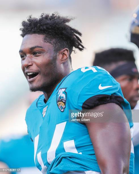 Myles Jack of the Jacksonville Jaguars looks on before the start of a preseason game against the Atlanta Falcons at TIAA Bank Field on August 29 2019...