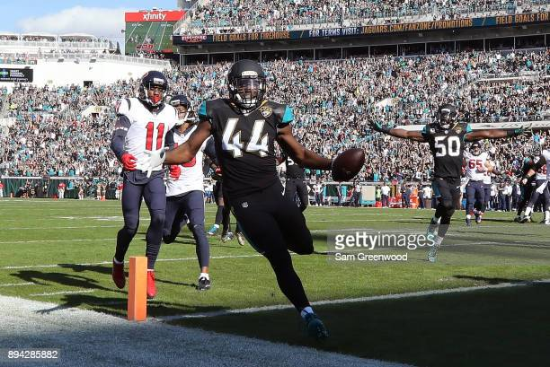 Myles Jack of the Jacksonville Jaguars runs with the football during the first half of their game against the Houston Texans at EverBank Field on...
