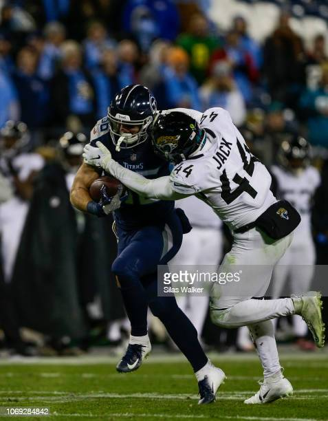 Myles Jack of the Jacksonville Jaguars tackles Anthony Firkser of the Tennessee Titans while he runs with the ball during the fourth quarter at...