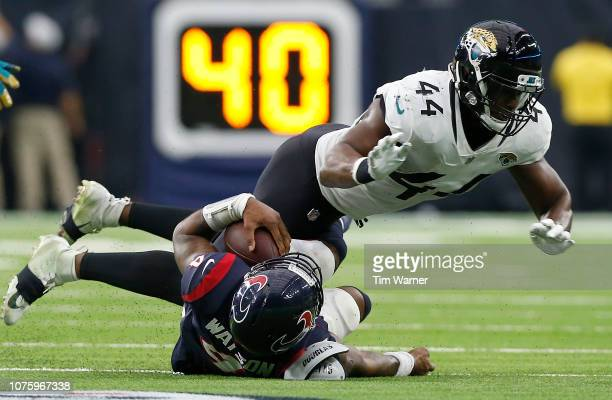 Myles Jack of the Jacksonville Jaguars tackles Deshaun Watson of the Houston Texans in the fourth quarter at NRG Stadium on December 30, 2018 in...