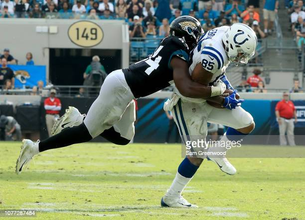 Myles Jack of the Jacksonville Jaguars tackles Eric Ebron of the Indianapolis Colts during the game on December 02, 2018 in Jacksonville, Florida.