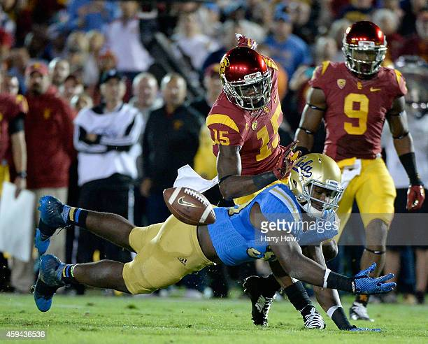 Myles Jack of the UCLA Bruins misses a chance for an interception in front of Nelson Agholor of the USC Trojans at the Rose Bowl on November 22 2014...