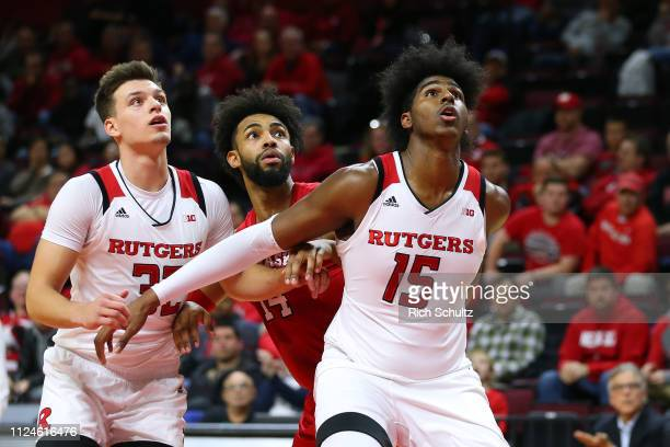 Myles Johnson and Peter Kiss of the Rutgers Scarlet Knights in action against Isaac Copeland Jr #14 of the Nebraska Cornhuskers during a game at...