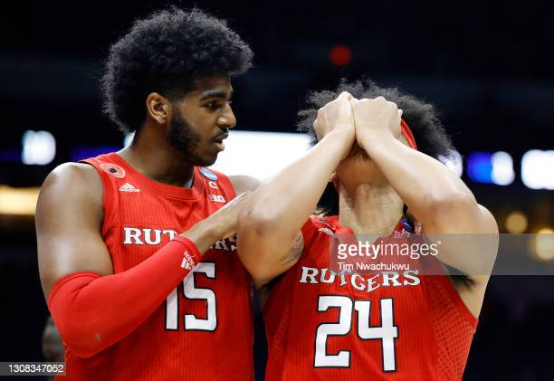Myles Johnson and Ron Harper Jr. #24 of the Rutgers Scarlet Knights react as the leave the court after being defeated by the Houston Cougars 63-60 in...