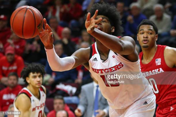 Myles Johnson of the Rutgers Scarlet Knights in action against James Palmer Jr #0 of the Nebraska Cornhuskers during a game at Rutgers Athletic...