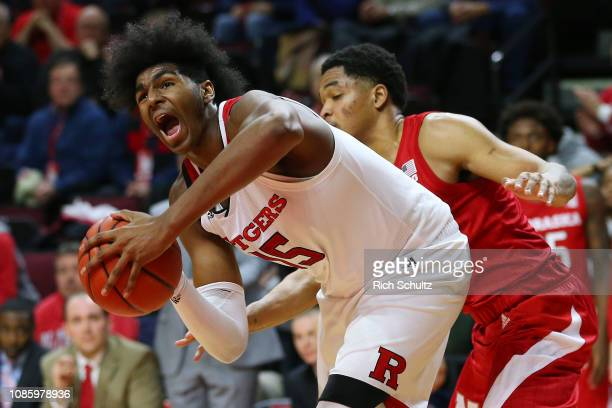 Myles Johnson of the Rutgers Scarlet Knights is fouled by James Palmer Jr #0 of the Nebraska Cornhuskers during the second half of a game at Rutgers...