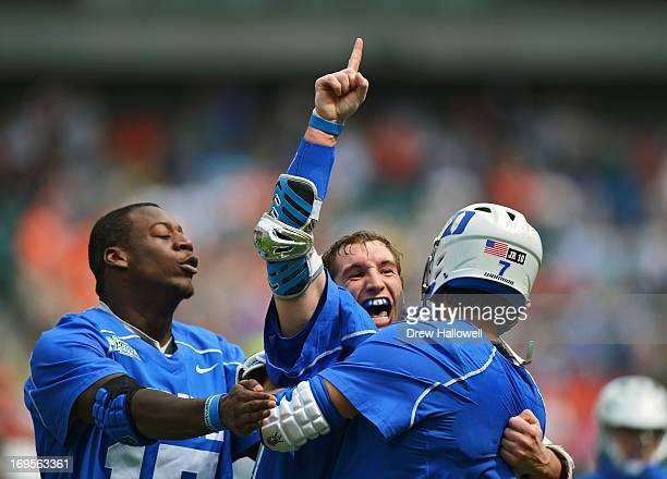 Myles Jones Josh Dionne and Jake Tripucka of the Duke University Blue Devils celebrate their 1610 win over the Syracuse University Orange for the...