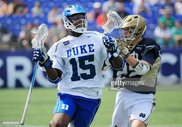 Myles Jones of the Duke Blue Devils works the ball around Jack Near of the Notre Dame Fighting Irish during the second half of the 2014 NCAA Division...