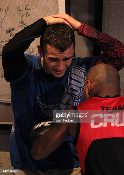 Myles Jury absorbs punches to the stomach by assistant coach Wilson Reis during a Team Cruz training session during season fifteen of The Ultimate...