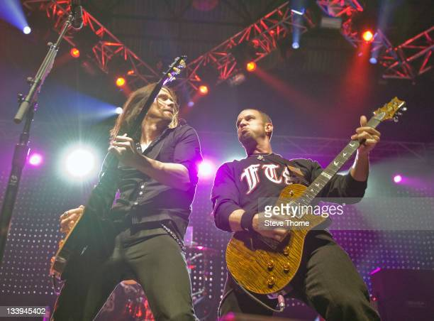 Myles Kennedy and Mark Tremonti of Alter Bridge perform on stage at LG Arena on November 22 2011 in Birmingham United Kingdom