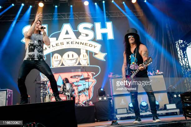 Myles Kennedy and Slash perform at the Lollapalooza Music Festival at Grant Park on August 04 2019 in Chicago Illinois