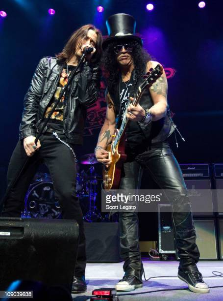 Myles Kennedy and Slash perform at The Palace of Auburn Hills on February 12 2011 in Auburn Hills Michigan