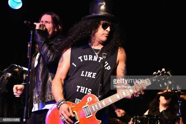 Myles Kennedy and Slash perform onstage with The Conspirators during a private concert for SiriusXM listeners at Santos Party House in New York City...