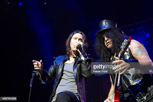 Myles Kennedy and Slash performs on stage at 3Arena on November 10, 2014 in Dublin, Ireland.