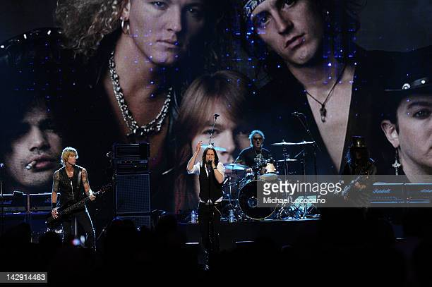 Myles Kennedy performs with inductees Duff McKagan and Slash of Guns N' Roses onstage during the 27th Annual Rock And Roll Hall of Fame Induction...