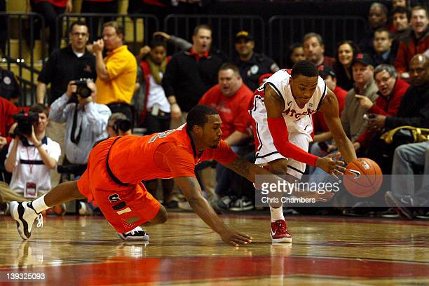 Myles Mack of the Rutgers Scarlet Knights attempts to control a loose ball against Kris Joseph of the Syracuse Orange in the second half at Louis...