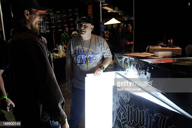 Myles Omand shows a marijuana enthusiast a grow box at the BC Northern Lights during the High Times US Cannabis Cup at the Exdo Center on April 21...