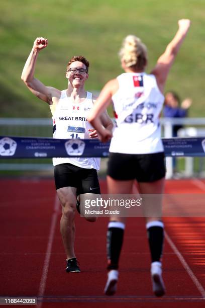 Myles Pillage celebrates towards teammate Kerenza Bryson of Great Britain as he approaches the finish line for them to win the Mixed Relay during Day...